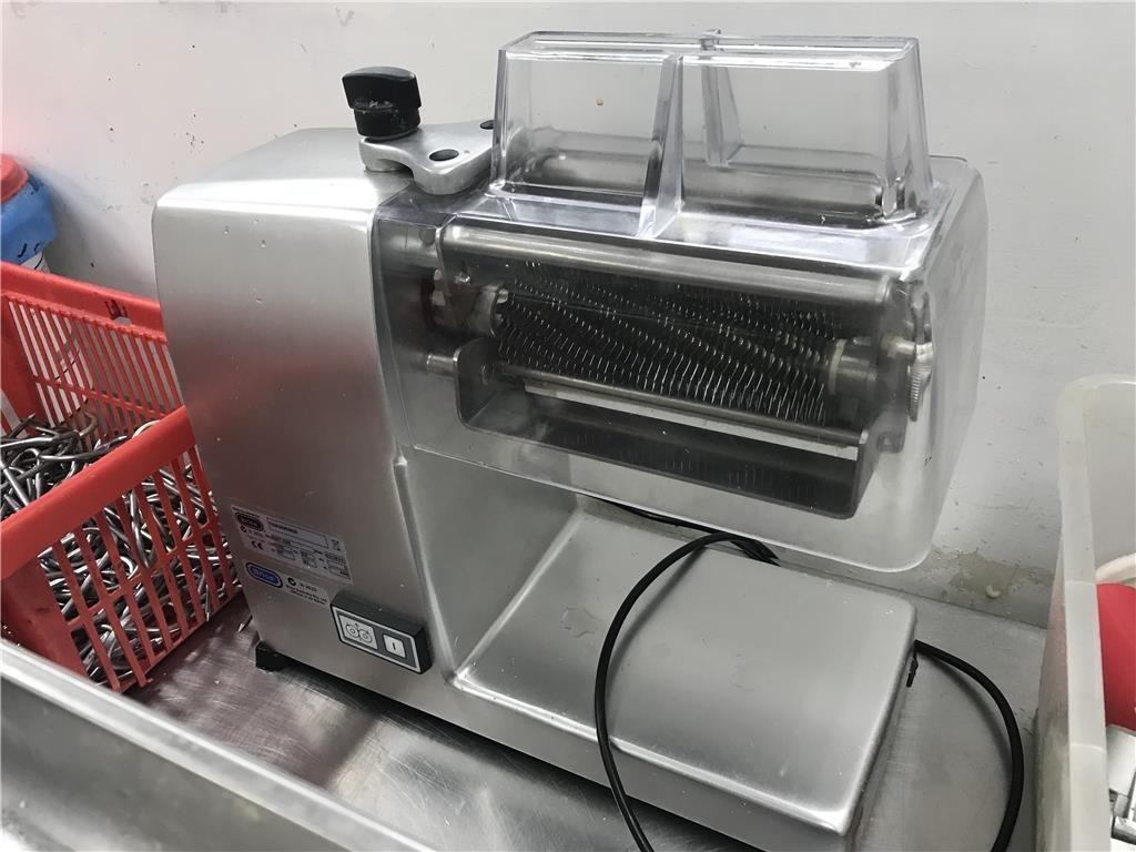 Photo of slicing machinery