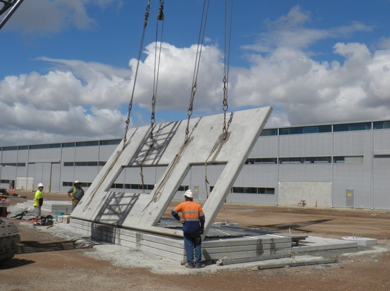 photo of precast concrete panel being lifted