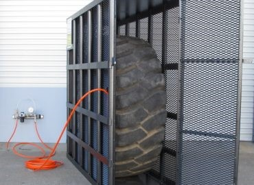 Second photo of tyre in inflation cage